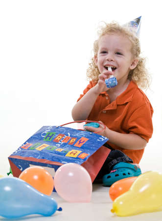 Cute young blond toddler jewish boy playing photo