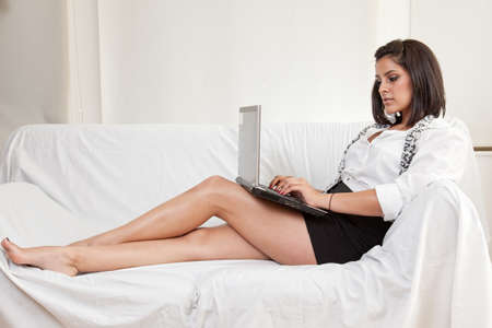 Pretty hispanic brunette woman in business clothes photo