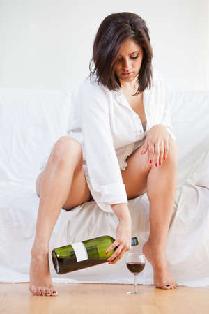 sleepwear: Sensual brunette hispanic woman relaxing and lounging Stock Photo