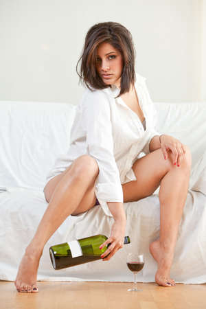 Sensual brunette hispanic woman relaxing and lounging photo