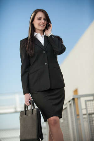 Pretty fashionable brunette caucasian business woman outdoor photo