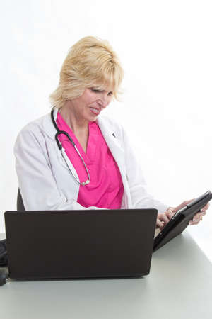 Attractive blond caucasian healthcare worker in her forties Stock Photo - 24828126