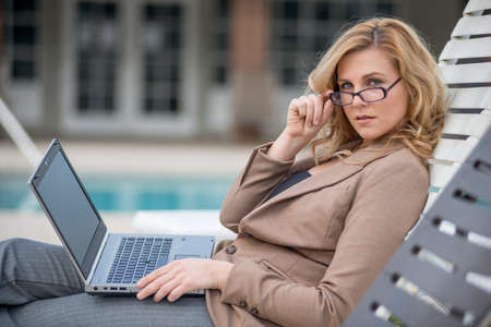 gorgeous businesswoman: Young twenties caucasian career woman working remote