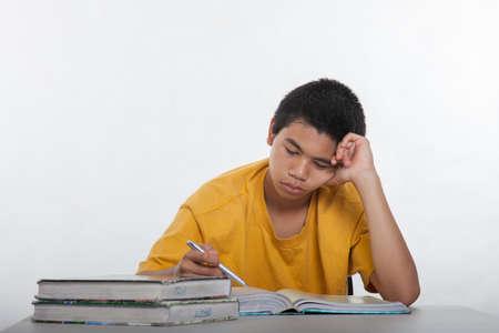 Teenage high school boy studying photo
