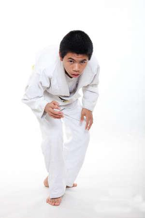 Young asian teen boy doing jiu jitsu martial arts photo