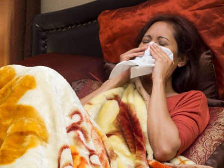colds: Woman sick of Colds on bed