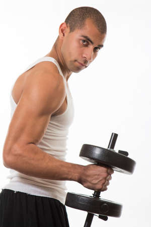 Physically fit hispanic man working out photo
