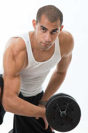 tank top: Physically fit hispanic man working out