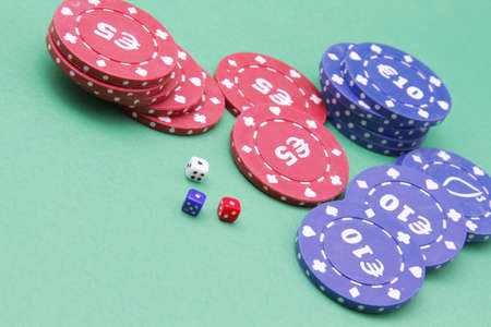 Dice and fiches on the green table Stock Photo - 13733689
