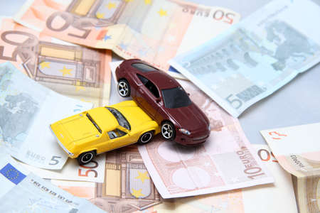 coachwork: Car accident with money as background Stock Photo