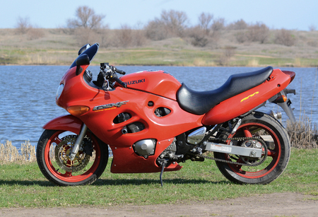 The red motorcycle (sport-tourist) against the background of the nature