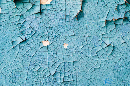 wall texture with cracked peeling blue paint