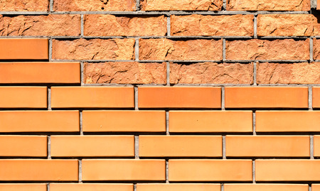 texture orange brick wall with damaged fragments Stok Fotoğraf