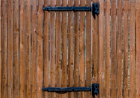 texture wooden fence with a wooden door on iron hinges Stok Fotoğraf