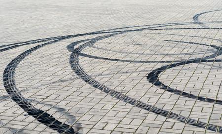 black marks of braking tires on car wheels on the road Reklamní fotografie
