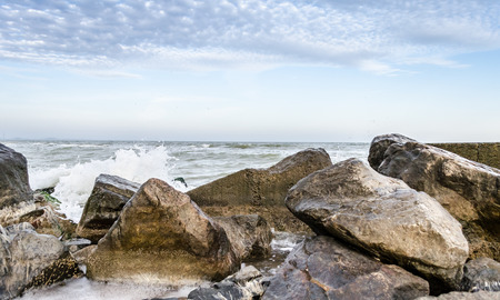 seascape with big stones and surf in the foreground Reklamní fotografie