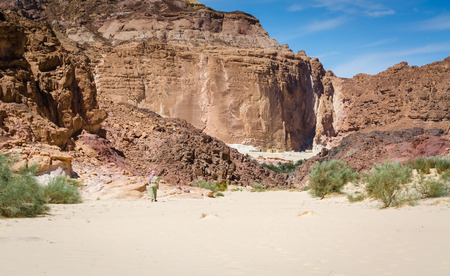 Bedouin goes to a village in the desert amid high rocky mountains in Egypt Dahab