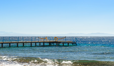 platform with orange lifeline in the Red Sea in Egypt Dahab