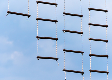 rope ladder against a blue sky and clouds