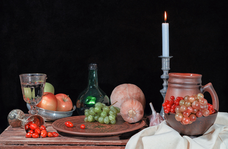 autumn still life with fruits and candle