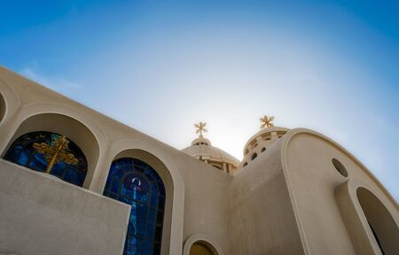 domes and crosses of a Christian church against the blue sky in Egypt in Sharm el Sheikh Stok Fotoğraf