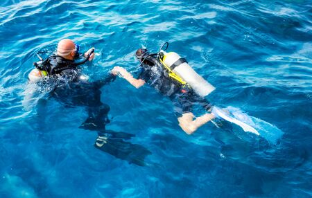 divers man and woman swim in the Red Sea in Egypt in Sharm El Sheikh