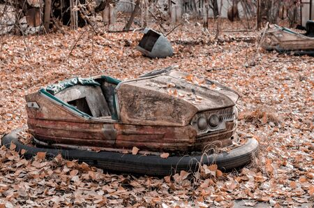 car and nobody in an abandoned amusement park in Chernobyl Ukraine in autumn