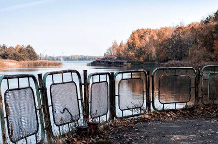 autumn landscape river and pier with a sunken destroyed house in Chernobyl in Ukraine Stok Fotoğraf