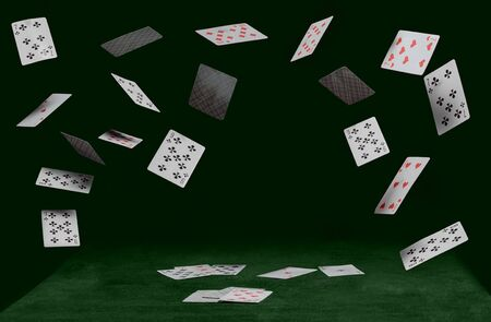 playing cards on green table on a dark background