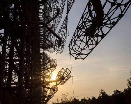secret army antenna radar in the forest at sunset with sun rays in Chernobyl Ukraine in autumn Stok Fotoğraf