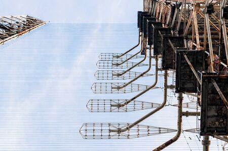 old secret army soviet radar on a background of blue sky and clouds in Chernobyl Ukraine