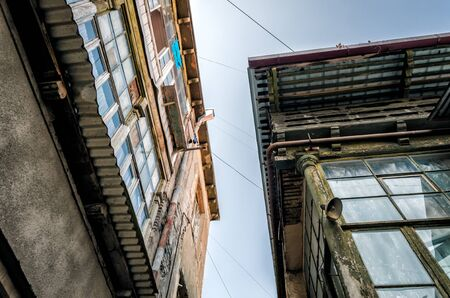 windows and roofs of old houses against the blue sky in the city of Tbilisi Georgia Stok Fotoğraf
