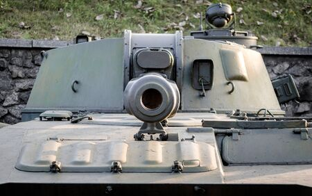 military army equipment armored tank on a city street in Ukraine close up
