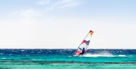 surfer rides in the Red Sea on the background of a clear sky in Sharm El Sheikh