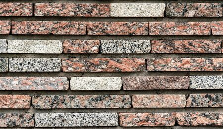 old colored brick wall architectural background pattern
