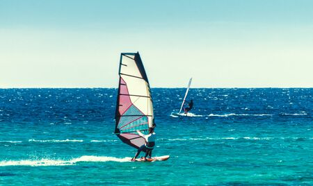 young surfer girl rides a sail in the Red Sea in Egypt Dahab Stok Fotoğraf