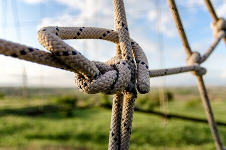many ropes and one big knot close up