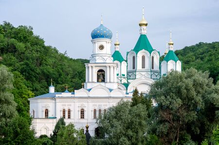 christian church in a green forest without people in Ukraine
