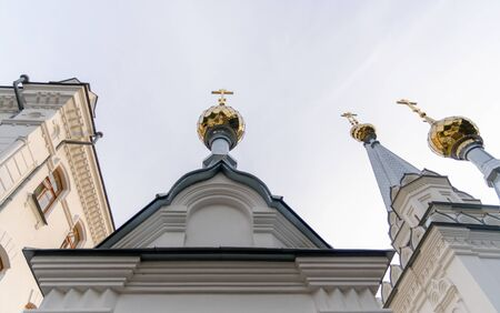 bottom view domes of christian church with crosses on blue sky background in Ukraine