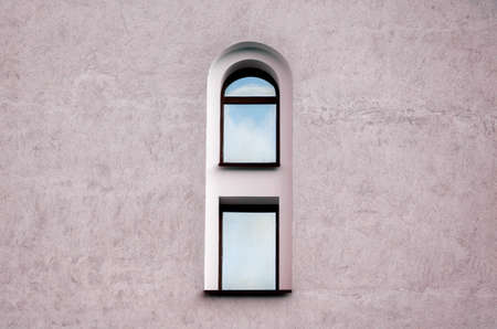 one window and gray wall of an old vintage building architectural background 스톡 콘텐츠