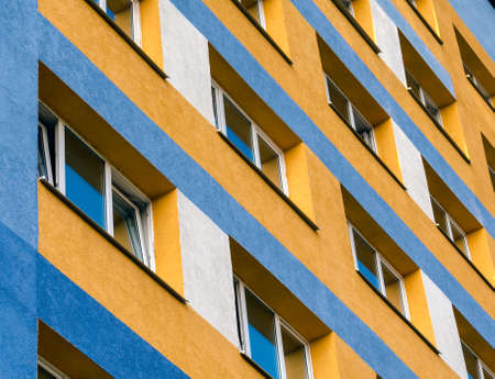 modern house with yellow and blue walls and empty windows without people quarantine isolation Stok Fotoğraf