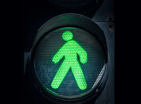 traffic light with green man on a black background abstract urban Stok Fotoğraf