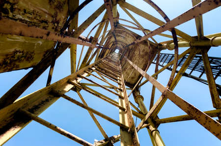 old tall tower with stairs bottom view abstract industrial background pattern