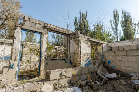 ruins of an old abandoned village house in Ukraine after the war Stok Fotoğraf