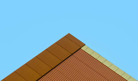 orange wall of a modern building against a blue sky abstract pattern