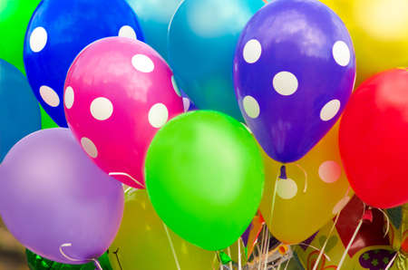 many bright colorful balloons with helium