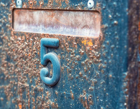 old metal rusty letterbox with number five