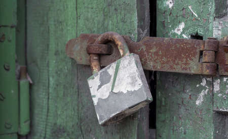 old vintage lock on a wooden door close up