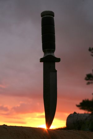 lag: a hunting knife in a lag on a sunset Stock Photo