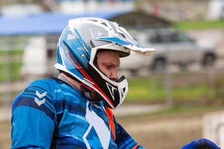 Close up view bikers face in helmet. Closeup portrait of a man in motorcycle helmet